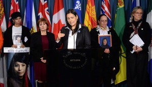 Native Women's Association of Canada President Michele Audette speaks during a press conference on Parliament Hill in Ottawa on Thursday, February 13, 2014, calling on the Conservative government to act on violence against women. THE CANADIAN PRESS/Sean Kilpatrick