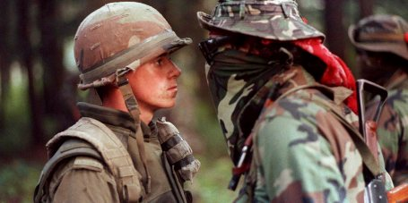 "Canadian soldier Patrick Cloutier and Saskatchewan Native Brad Laroque alias ""Freddy Kruger"" come face to face in a tense standoff at the Kahnesatake reserve in Oka, Que., Saturday September 1, 1990. It was a crisis that grabbed international headlines, with armed Mohawks and Canadian soldiers involved in a lengthy standoff that often appeared on the verge of exploding into full-blown combat. Twenty-five years on, the legacy of the Oka Crisis for many of those who experienced the tension west of Montreal is a greater awareness of native issues. THE CANADIAN PRESS/Shaney Komulainen"